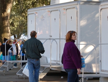 portable restroom trailers at park festival